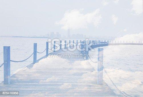 862431374 istock photo Double exposure, clouds and bridge. 825416956