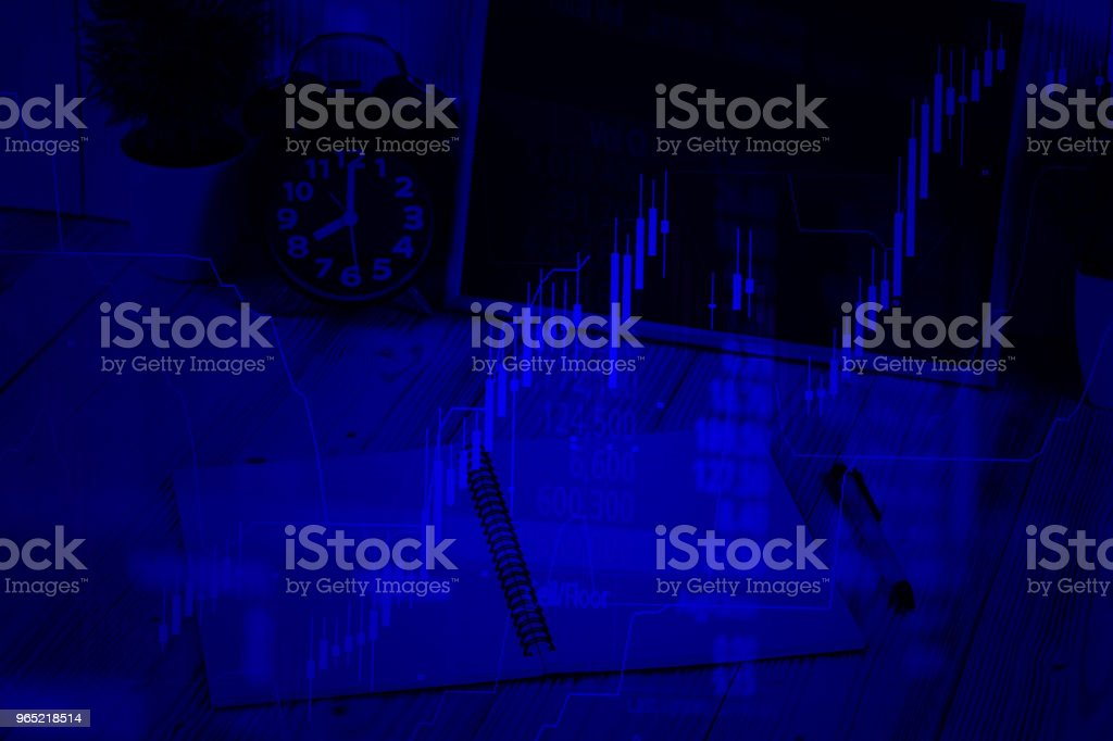 Double exposure coins stacks and alarm clock with green chalkboard, notebook and financial graph, with candle stick and stock market screen, business planning vision and finance analysis concept. royalty-free stock photo