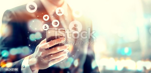 istock Double exposure concept, Businessman chats with his friend through mobile phone with special lighting effects. 1188243166