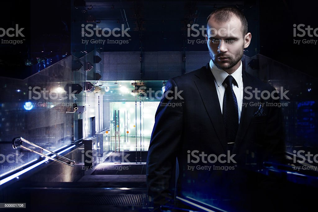 Double exposure concept, serious man in a business suit, dark stock photo