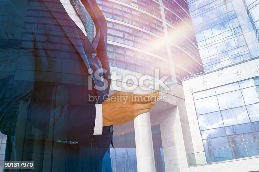 istock Double exposure concept with businessman silhouette with special lighting effects 901317970