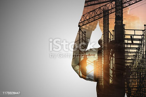 istock Double exposure concept with engineer  or foreman on construction site of background,copy space for text. 1173328447