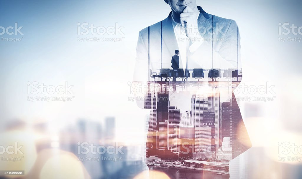Double exposure concept with thinking businessman stock photo