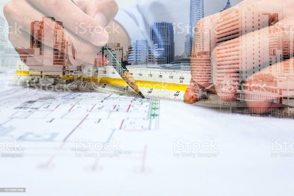 Double exposure engineer drawing and city stock photo