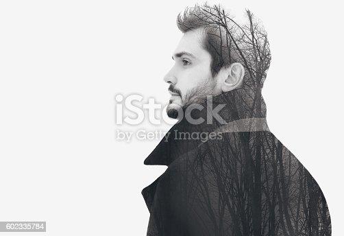 istock Double exposure fashion elegant bearded free man 602335784