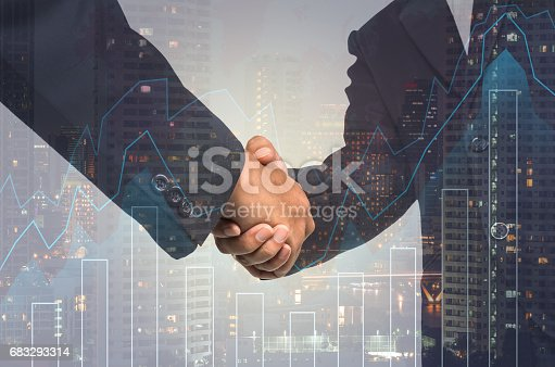 611747524istockphoto Double exposure handshake between businessman on cityscape and financial graph background, Business Trading concept 683293314