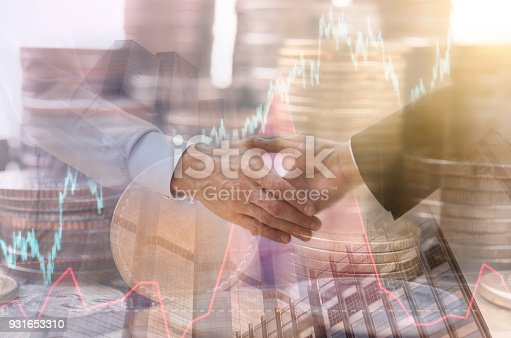 istock Double exposure handshake with stock graph and coin money. concept business  achievement economy finance. 931653310