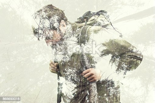 istock Double exposure hiker into the forest 865693018