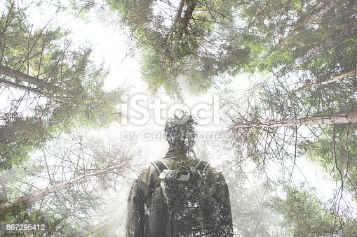istock double exposure hiker walking in a mystic forest 867295412