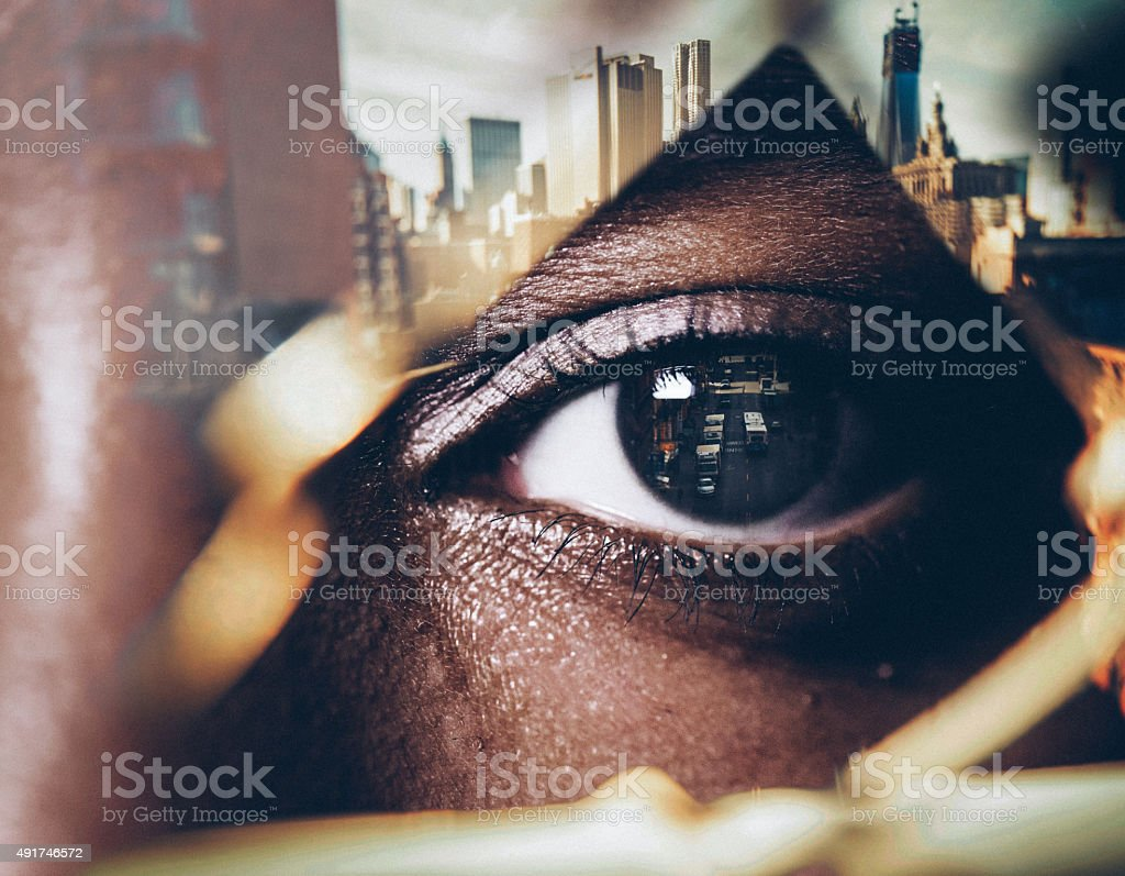 Double exposure image of a human eye with cityscape stock photo