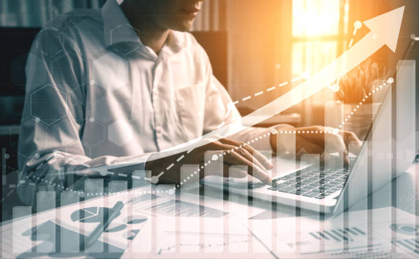 Double Exposure Image of Business Profit Growth Double Exposure Image of Business and Finance - Businessman with report chart up forward to financial profit growth of stock market investment. cheap stock pictures, royalty-free photos & images
