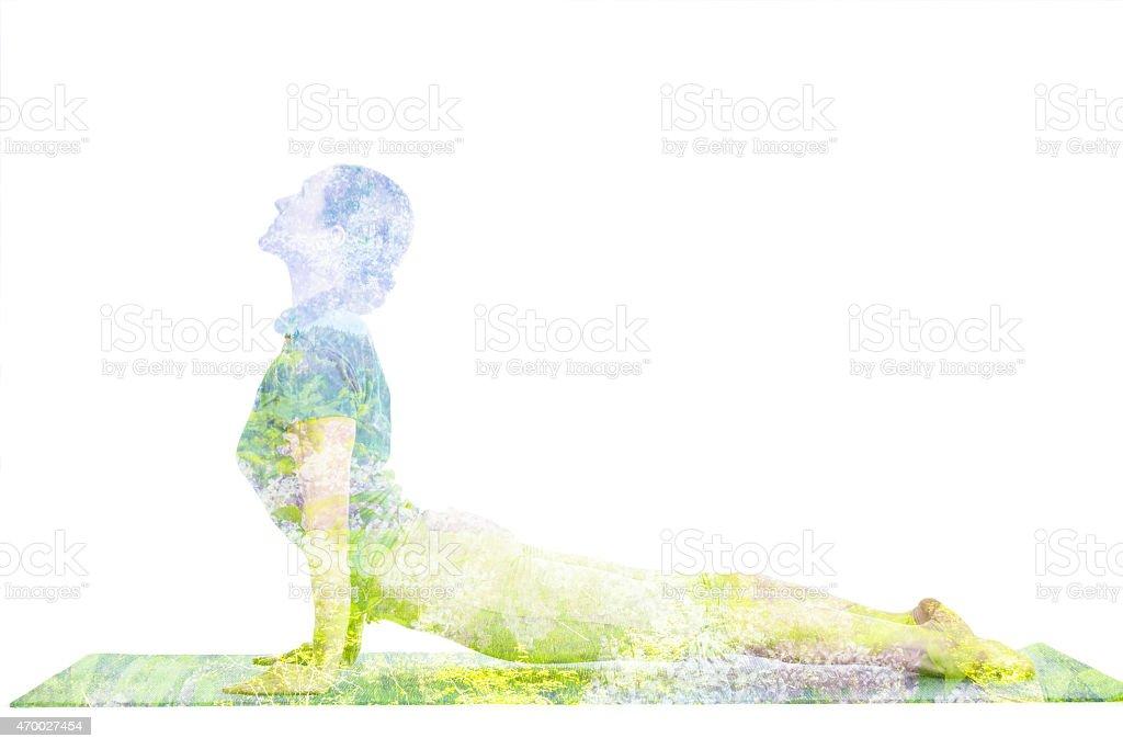 Double exposure image of  woman doing yoga asana stock photo