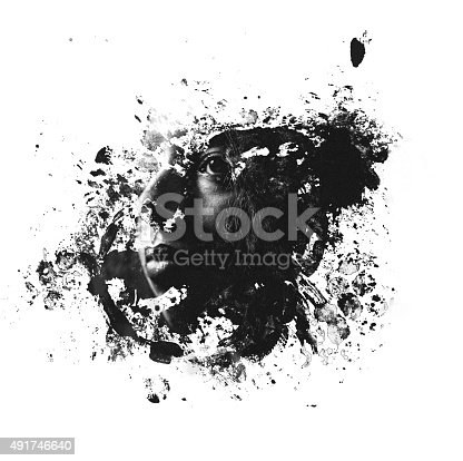 Monochrome image of a graphic splatter shape with a woman's face within it using a double exposure photographic effect