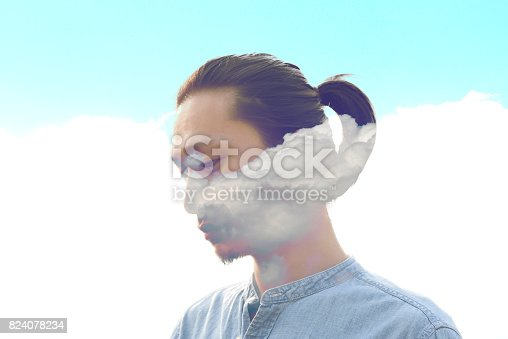 498089686 istock photo Double exposure man and and blue clouds. Creative portrait. 824078234