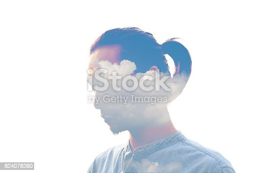 istock Double exposure man and and blue clouds. Creative portrait. 824078260