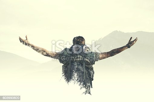 istock Double exposure man reach the top of the mountain 603993820