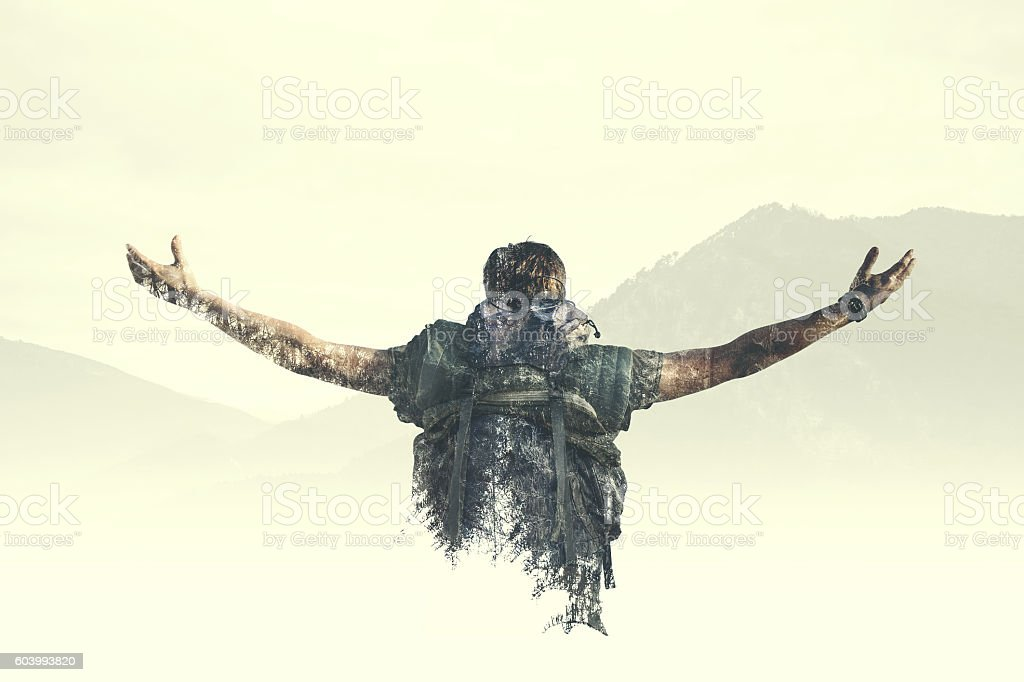 Double exposure man reach the top of the mountain stock photo