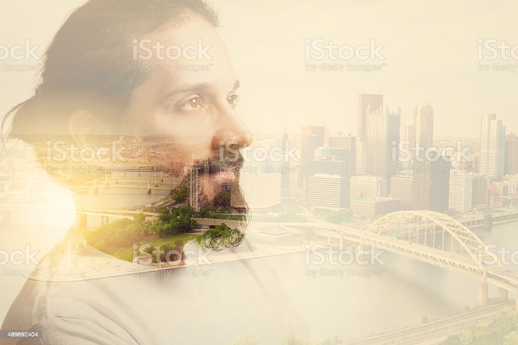 Double Exposure Man With Beard And City stock photo