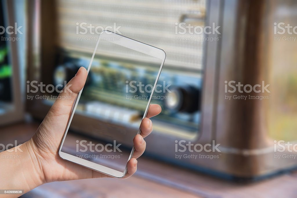 Double exposure mobile over blurred image of radio stock photo