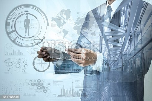 istock double exposure of a business person and modern office interior, futuristic GUI(Graphical User Interface), IoT(Internet of Things), technological abstract 681768546