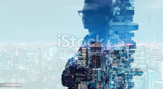 istock Double exposure of a businessman and smart city. 1159996638