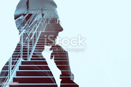 994786356 istock photo Double exposure of a businessman and stairs. Success of business concept. 1004013354
