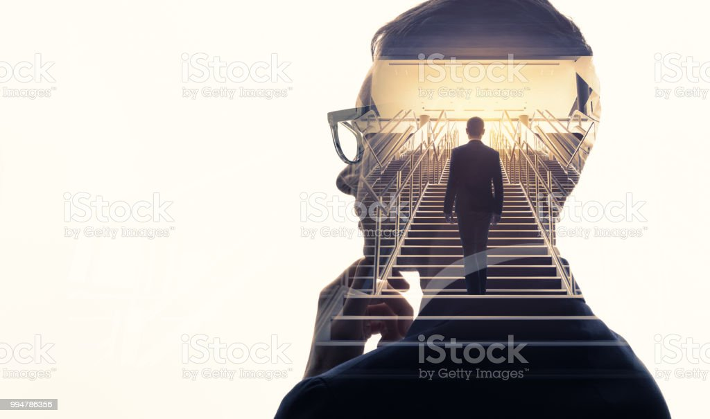 Double exposure of a businessman and stairs. Success of business concept. - foto stock