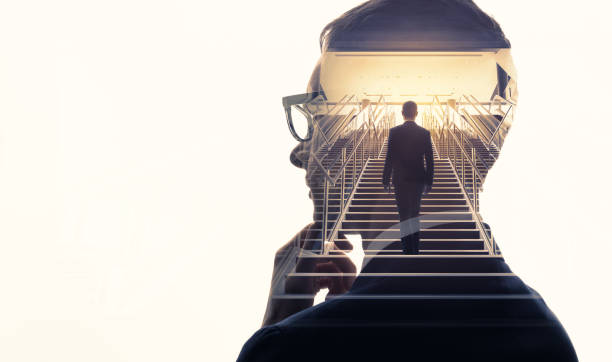 Double exposure of a businessman and stairs. Success of business concept. stock photo