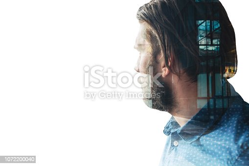 1079450712 istock photo Double exposure of a businessman with business district building 1072200040