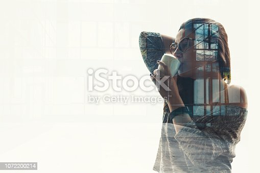 994786356 istock photo Double exposure of a businesswoman with business district building 1072200214