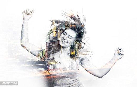 istock Double exposure of a dancing woman 865537724