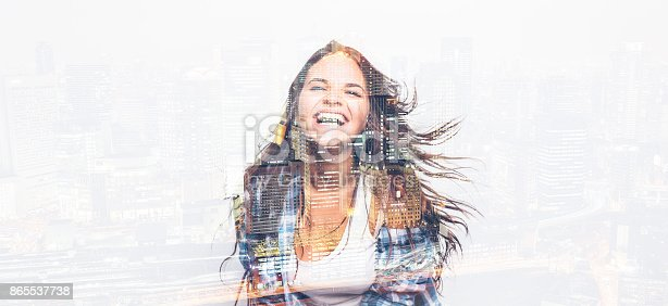 Double exposure of a happy dancing woman.