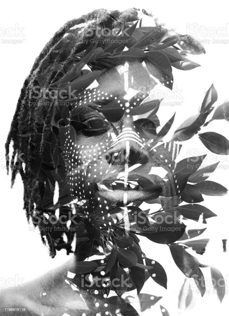 Double Exposure Of A Dark Skinned Man With Dreadlocks And