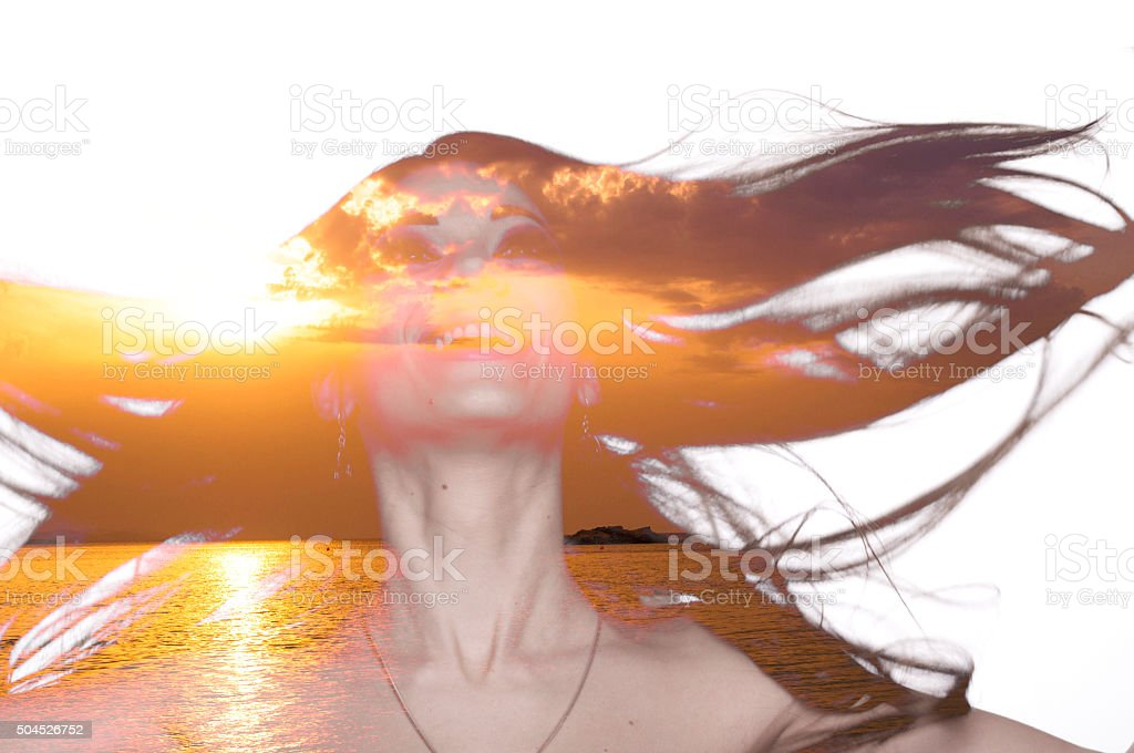 Double exposure of a female portrait and sea sunset stock photo