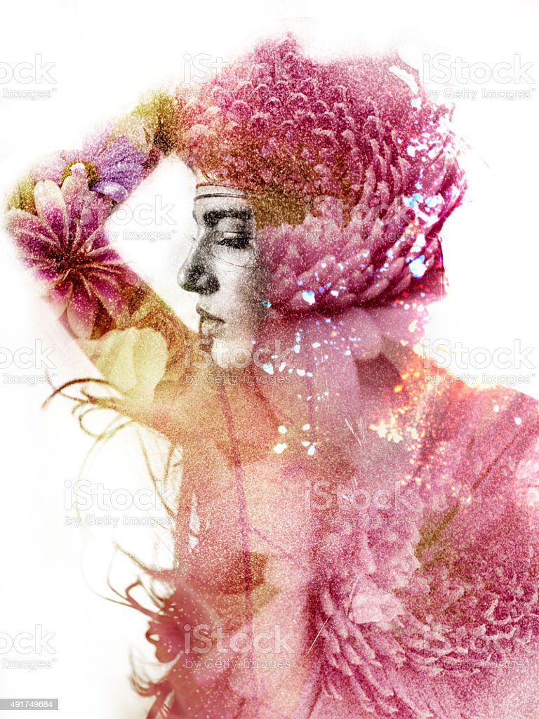 Double exposure of a woman's silhouette filled with dahlia flowers stock photo