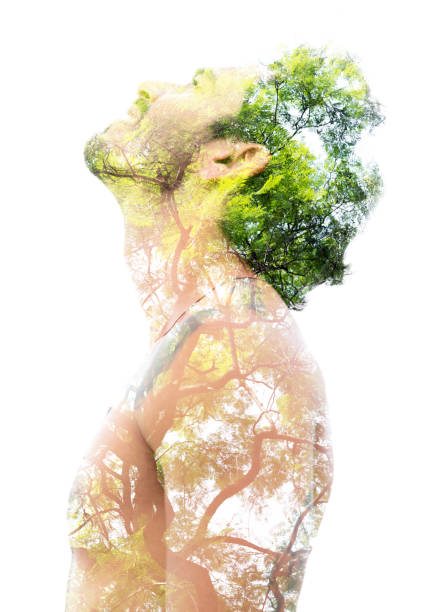 Double exposure of a young bare-chested man's portrait blended with bright green leaves, showing the perfect beauty of nature's creation stock photo