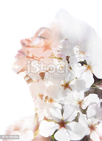 istock Double exposure of a young natural beauty relaxing and softly tilting her head back as her forehead and hair combines perfectly with delicate fragrant white flowers 876195494
