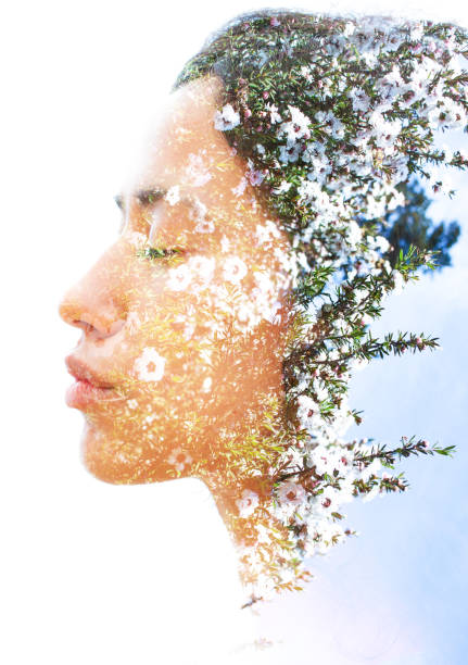 double exposure of a young natural beauty with strong sexy features dissolves into a photograph of delicately fragrant white flowers - aromatherapy stock photos and pictures