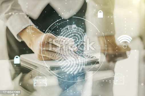 957759714 istock photo Double exposure of abstract creative fingerprint hologram with man hand writing in notepad on background, protection of personal information concept 1216542093
