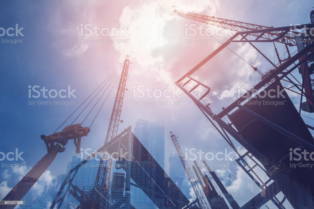 Double exposure of abstract real estate construction site and cityscape buildings background.Vintage tone stock photo
