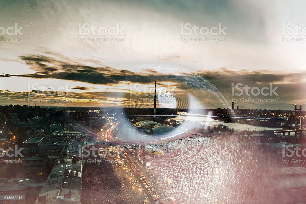 Double exposure of an eye with city stock photo
