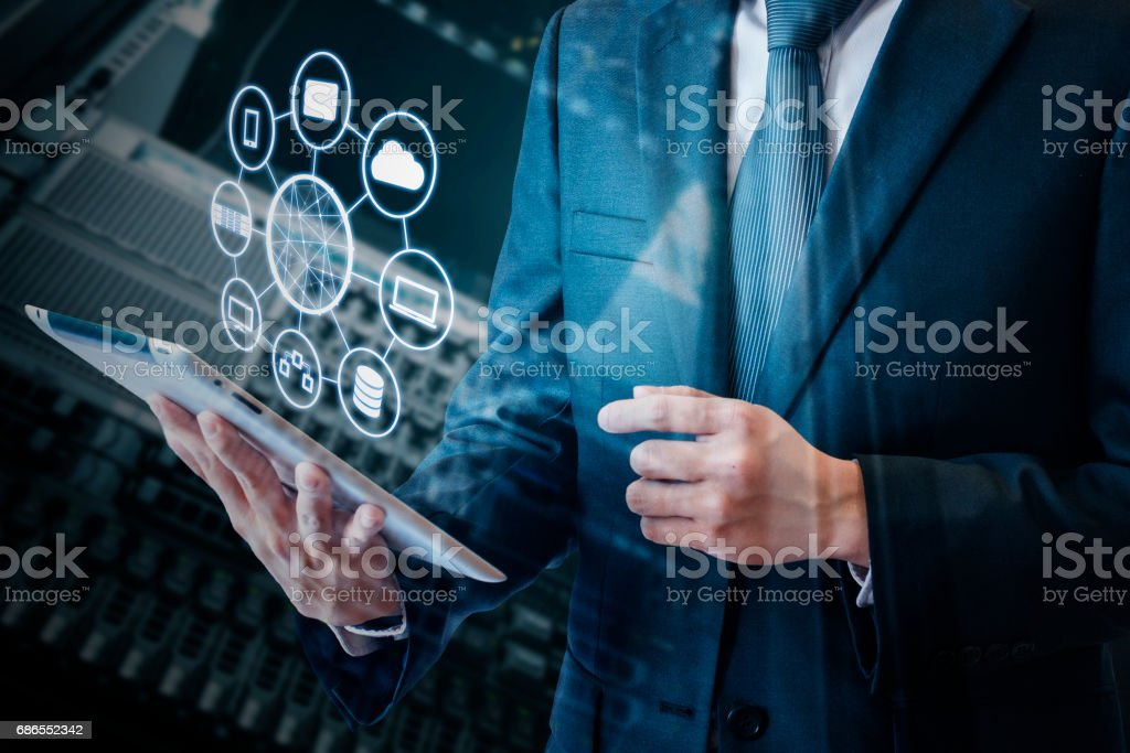 Double exposure of asian business man using tablet connected internet network and devices, concept of technology stock photo