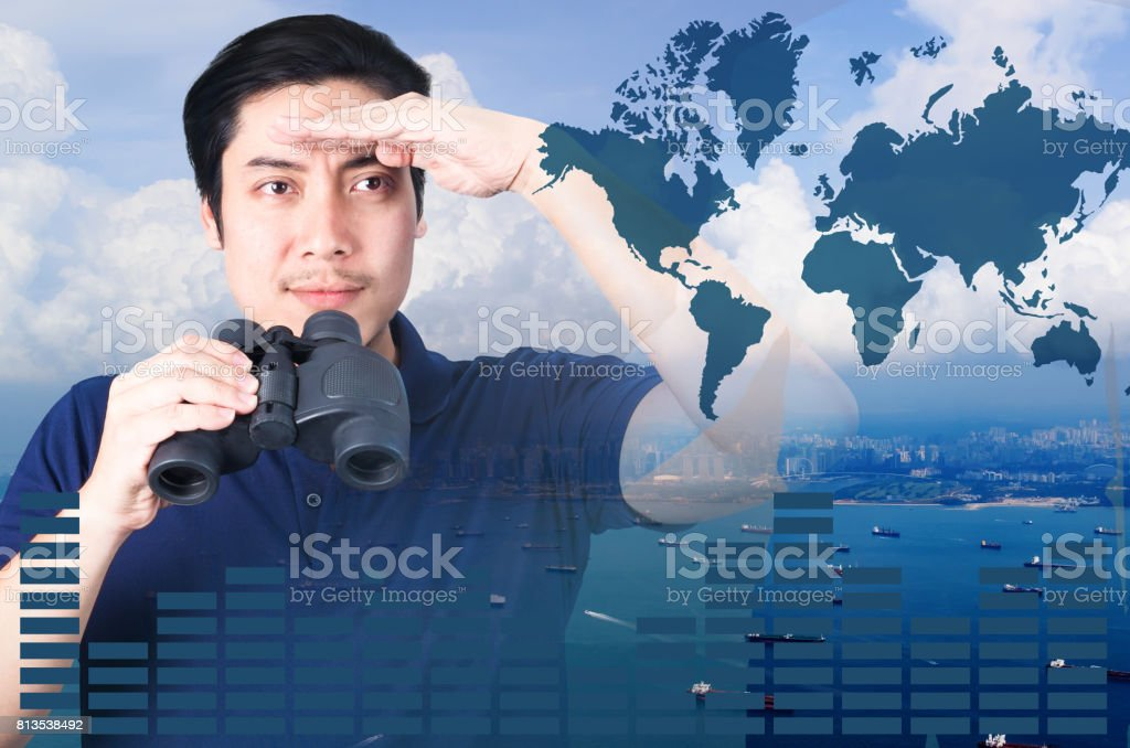 Double exposure of Asian investor with binoculars. Over seascape view and world map, furnished by NASA. stock photo