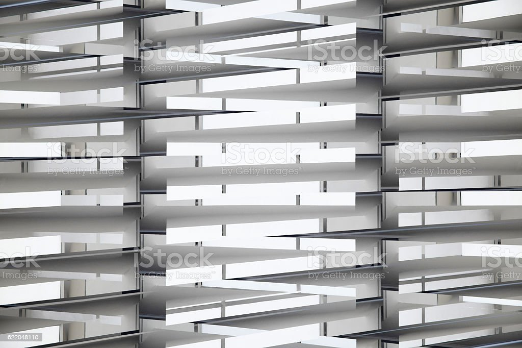 Double exposure of backlit industrial interior fragment with louvered structure stock photo