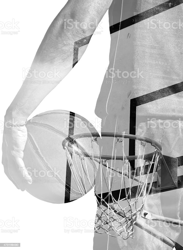 double exposure of basketball player and hoop in bw stock photo