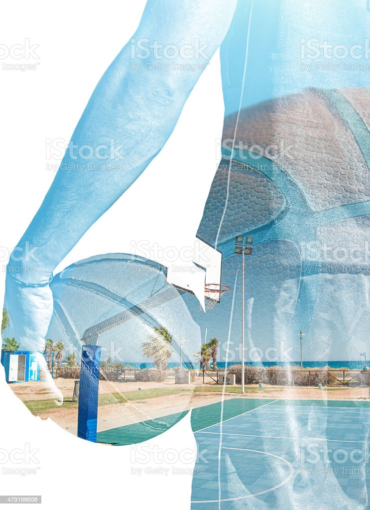 double exposure of basketball player and hoop stock photo