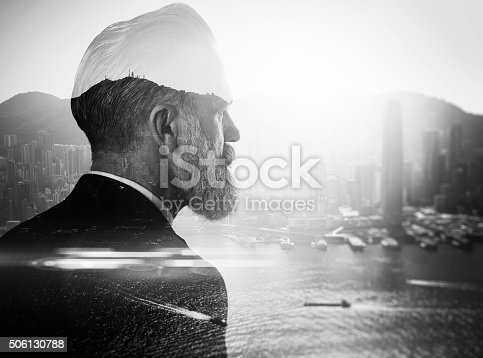 istock BW double exposure of bearded businessman and contemporary city on 506130788