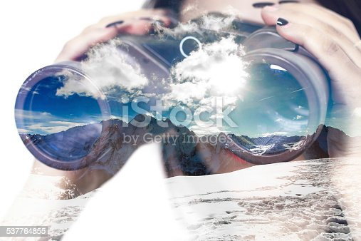 istock Double exposure of binoculars and mountainscape 537764855