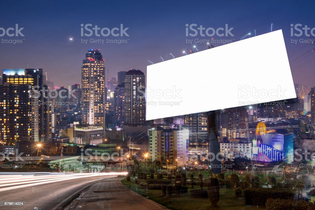 Double exposure of blank billboard for business advertisement with...