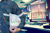istock Double exposure of  business man or Engineer holding helmet with stock trading room and stock trading chart background for investment business concept. 1153433716